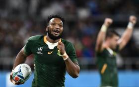 FILE: South Africa's centre Lukhanyo Am runs to score a try during the Japan 2019 Rugby World Cup Pool B match between South Africa and Italy at the Shizuoka Stadium Ecopa in Shizuoka on 4 October 2019. Picture: AFP