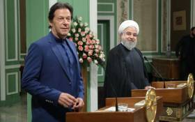 A handout picture provided by the Iranian Presidency on 13 October 2019 shows President Hassan Rouhani (R) and Pakistan's Prime Minister Imran Khan giving a joint press conference in the Iranian capital Tehran. Khan visited Iran following a request from the United States and Saudi Arabia for him to try to defuse rising tensions in the Gulf. Picture: AFP.