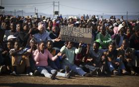 Hundreds of Zwelihle residents gathered at the sports ground where Police Minister Bheki Cele addressed them. Picture: Cindy Archillies/EWN