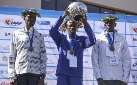 Third place winner Philemon Kacherian (right), second place winner Albert Korir (left) and first place winner Stephen Mokoka (center). Picture: Cindy Archillies/EWN