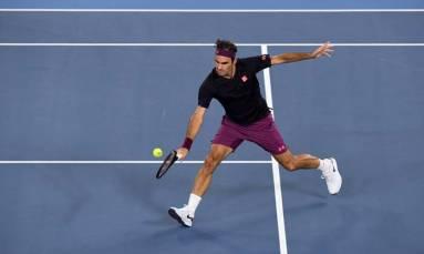 Federer, Williams duck downpours at wet, wet, wet Australian Open