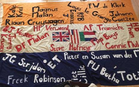 The old South African flag with the names of people activist Johan Pienaar says were the architects and enablers of apartheid. Picture: @JohanPienaar/Twitter.
