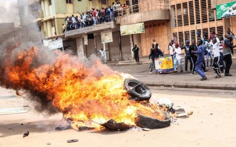 Protesters set a bonfire on a street to demand the release of the Ugandan politician Robert Kyagulanyi, known as Bobi Wine, who was recently arrested for treason and possession of firearms in Kampala, Uganda, on 20 August 2018. Picture: AFP.