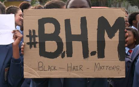 Sans Souci students protest outside of their school to highlight the alleged racist hair and language policies of the institution. Picture: Anthony Molyneaux/EWN