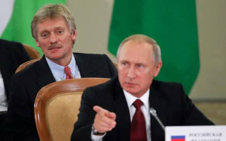 FILE: Russia's President Vladimir Putin (front) and Kremlin spokesman Dmitry Peskov attend a session of the Council of Heads of the Commonwealth of Independent States (CIS) in Sochi on 11 October 2017. Picture: AFP.