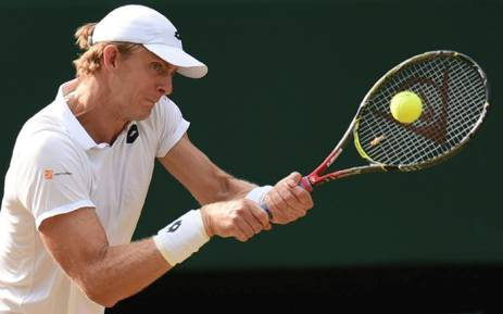 South Africa's Kevin Anderson returns against US player John Isner during their men's singles semi-final match on the eleventh day of the 2018 Wimbledon Championships at The All England Lawn Tennis Club in Wimbledon, southwest London, on 13 July  2018. Picture: AFP.