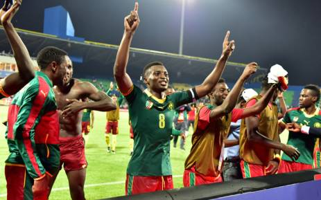 Cameroon's players celebrate at the end of the 2017 Africa Cup of Nations semi-final football match between Cameroon and Ghana in Franceville on 2 February, 2017. Picture: AFP.