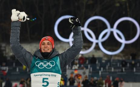 Gold medallist Germany's Eric Frenzel reacts on the podium following the Nordic combined men's individual normal hill NH/10km final at the Alpensia cross-country centre during the Pyeongchang 2018 Winter Olympic Games on 14 February 2018 in Pyeongchang. Picture: AFP