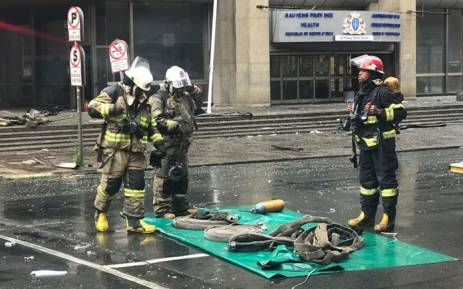 Firefighters begin clearing away equipment on 7 September 2018 near the Lisbon Building following the deadly fire there earlier this week. Picture: Christa Eybers/EWN