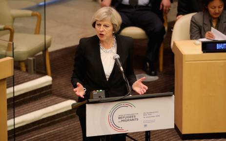 British Prime Minister Theresa May addresses delegates as she delivers a keynote speech on the refugee crisis at the United Nations General assembly on 19 September, 2016 in New York City. Picture: AFP.