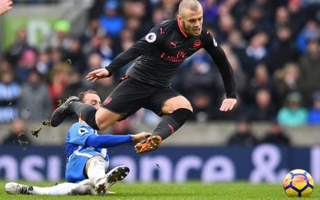 Arsenal's Jack Wilshere in action with Brighton's Glenn Murray. Picture: @Arsenal/Twitter.