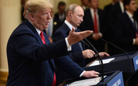 US President Donald Trump (L) and Russian President Vladimir Putin are pictured ahead of their meeting in Helsinki, on 16 July 2018. Picture: AFP.