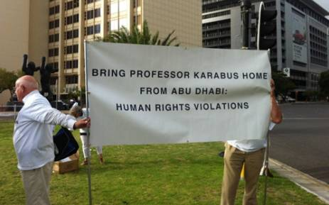 Supporters of Doctor Cyril Karabus, who faces manslaughter charges in the UAE, picketed outside the CTICC on 18 February 2013. Picture: Carmel Loggenberg/EWN