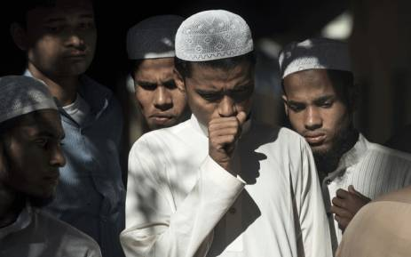 Bangladeshi people react as they look at the bodies of Rohingya Muslim refugees in Shah Porir Dwip Island on 9 October 2017 after a boat capsized. Picture: AFP.