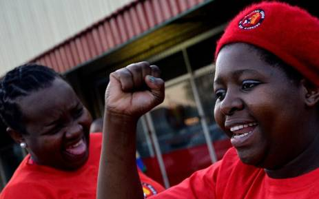 FILE: Striking mine workers who support the National Union of Mineworkers take part in a protest in Carletonville on 3 September 2013. Picture: AFP.
