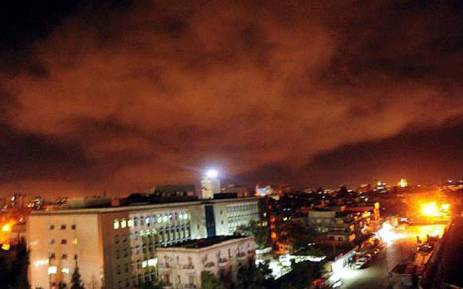 A photo released on 14 April 2018 the twitter page of the Syrian government's central military media shows an explosion on the outskirts of Damascus after Western strikes reportedly hit Syrian military bases and chemical research centres in and around the capital.  Picture: AFP.