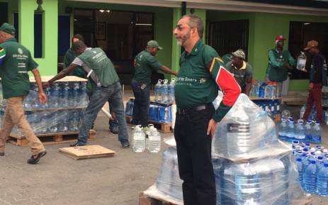 Gift of the Givers' Imtiaz Sooliman oversees the packaging of water bottles for distribution in drought-hit Cape Town and the Western Cape. Picture: Kevin Brandt/EWN