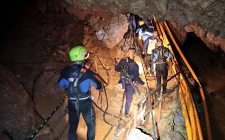 This undated handout photo taken recently and released by the Royal Thai Navy on July 7, 2018 shows a group of Thai Navy divers in Tham Luang cave during rescue operations for the 12 boys and their football team coach trapped in the cave at Khun Nam Nang Non Forest Park in the Mae Sai district of Chiang Rai province. Picture: AFP.
