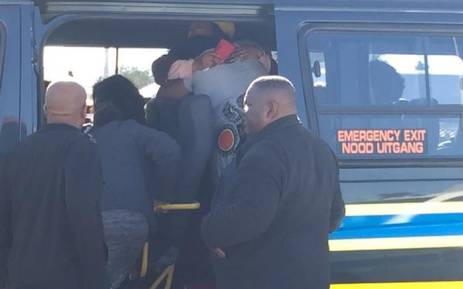 FILE: Family members of the woman killed during Tembisa taxi rank shooting console each other at the scene on 28 July 2015. Picture: Govan Whittles/EWN.