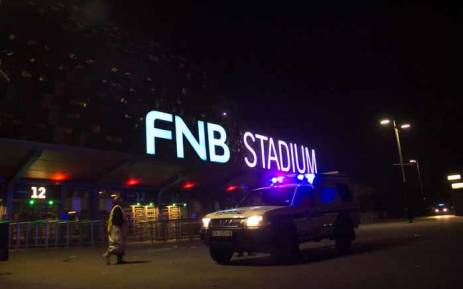FILE: Emergency service marshals and vehicles leave from the FNB Stadium where two people died during a stampede which occurred at one of the entrances to the stadium on 29 July 2017 in Johannesburg. Picture: AFP.