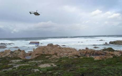 The chokka fishing boat 'Maredon' capsized at Sunset Rocks, Cape St Francis and the SAAF 15 Squadron Charlie Flight BK-117 helicopter overhead. Picture: NSRI