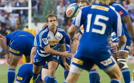 Nic Groom (L) of the Stormers, clears the ball out of a scrum during the Super Rugby match between the Stormers and the Chiefs at Newlands Rugby Stadium in Cape Town on 9 March 2013. Picture: AFP