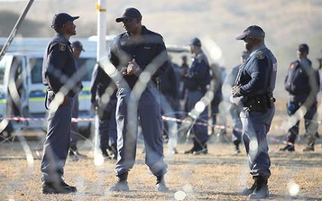 FILE: Police closely monitor protests in Marikana in the North West on 14 August 2012. Picture:EWN.
