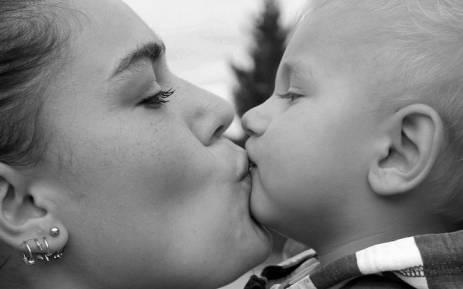 family-kiss-mother-babyjpg