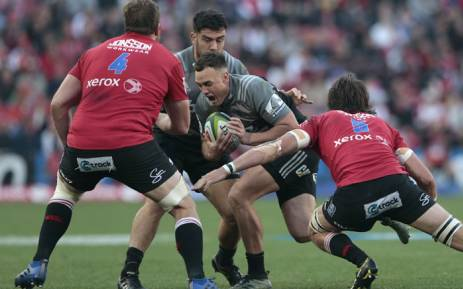 FILE: Crusaders' New Zealand Isral Dagg (C) runs with the ball during the Super Rugby final match between Lions and Crusaders at the Ellis Park Rugby stadium on 5 August 2017 in Johannesburg. Picture: AFP