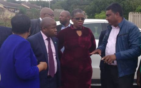 Cooperative Governance Minister Des van Rooyen (L) next to eThekwini Mayor Zandile Gumede on a visit to Isiphingo on 13 October 2017 to assess the damage done by recent storms. Picture: Twitter/@NationalCoGTA