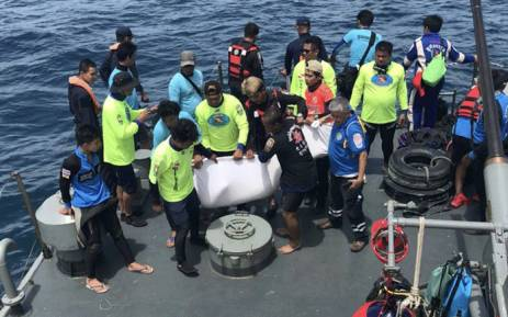 Thai rescue personnel aboard a search and rescue ship recover a body from a capsized tourist boat at sea off Phuket on 6 July, 2018. Picture: AFP.