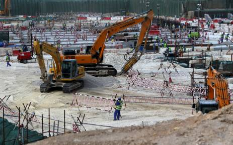 FILE: Foreign labourers work at the construction site of the al-Wakrah football stadium, one of the Qatar's 2022 World Cup stadiums, in May 2015. Picture: AFP.