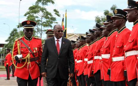 Tanzanian President John Magufuli reviews a military honour guard before attending the launching ceremony of a one-stop border post to speed up slow customs processing at the border in Mutukula, Uganda, on 9 November 2017. Picture: AFP