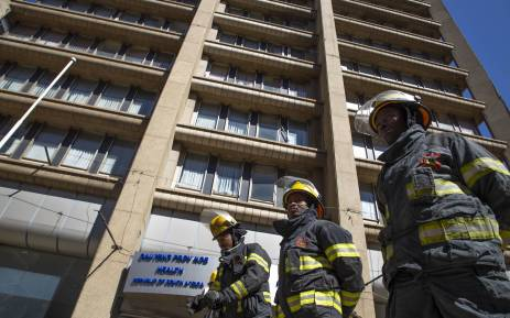 Firefighters stand in front of the Bank of Lisbon building where 3 of their colleagues died while trying to extinguish a fire. A memorial service was held for the firefighters on 12 September 2018. Picture: Christa Eybers/EWN