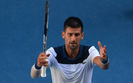 Serbia's Novak Djokovic celebrates beating France's Gael Monfils in their men's singles second round match on day four of the Australian Open tennis tournament in Melbourne on 18 January 2018. Picture: AFP