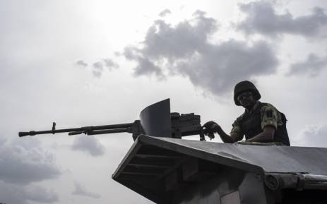 FILE: In this file photo taken on 17 April 17 2018 a member of the Nigerian Military Police sits on an armoured vehicle during the African Land Forces Summit (ALFS) military demonstration held at General Ao Azazi barracks in Gwagwalada. At least 30 Nigerian soldiers died in combat with Boko Haram jihadists who overran a military base in the northeast near the border with Niger, two military sources told AFP on 1 September 2018. Picture: AFP.