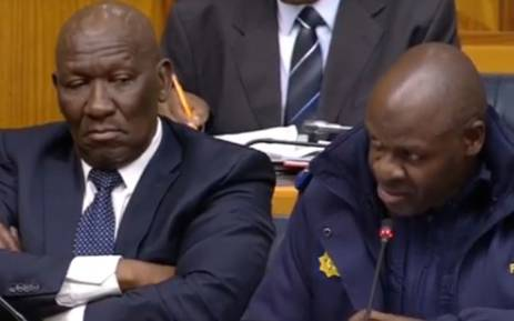 A screengrab of Police Minister Bheki Cele (left) and National Police Commissioner Khehla Sitole briefing MPs on the SAPS plan to combat cash-in-transit heists.