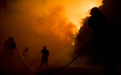 Firefighters battles the blaze. Picture: Thomas Holder/EWN