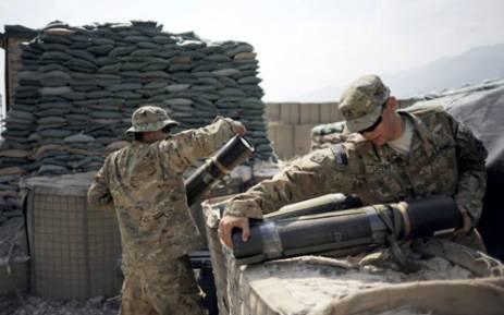Soldiers of the 4th brigade combat team 4th infantry division of the U.S. Army clean a mortar range at the Forward Operating Base Joyce, in the Kunar province of Afghanistan. Picture: AFP.