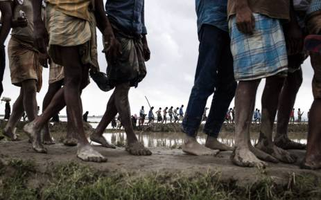 In September 2017, newly arrived Rohingya refugees from Myanmar walk through paddy fields and flooded land after they fled over the border into Cox's Bazar district, Chittagong Division in Bangladesh. Picture: Unicef.