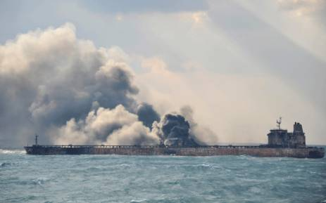 """This handout picture taken on 9 January and released on 10 January 2018 by the Transport Ministry of China shows smoke and flames coming from the burning oil tanker """"Sanchi"""" at sea off the coast of eastern China. Picture: AFP."""