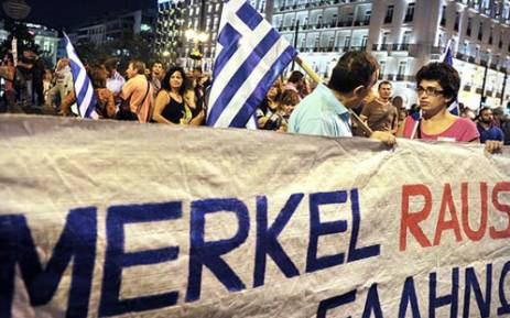 Greek protestors gather in Athens to demonstrate against the state visit of German Chancellor Angela Merkel on 9 October, 2012 as the euro economic crisis worsens. Picture: AFP.