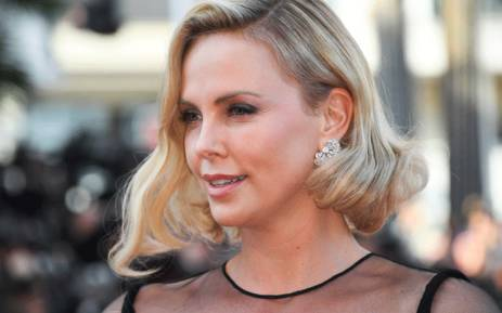 FILE: Actress Charlize Theron poses as she arrives on 23 May 2017 for the '70th Anniversary' ceremony of the Cannes Film Festival in Cannes, southern France. Picture: AFP