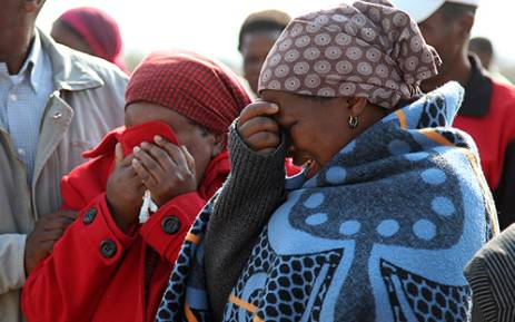 FILE: Family members mourn at a memorial service for the Marikana miners who were killed in a shootout with police on 16 August 2012. Picture: EWN.