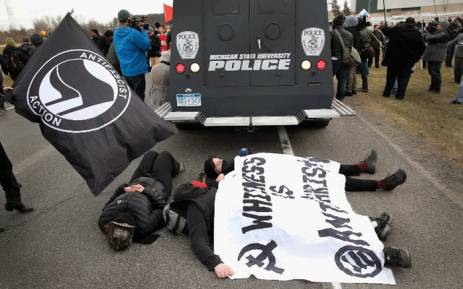 Demonstrators clash with police before the start of a speech by white nationalist Richard Spencer, who popularized the term 'alt-right', at Michigan State University on 5 March, 2018 in East Lansing, Michigan. Picture: AFP.