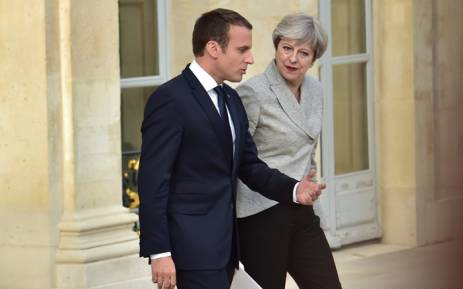 FILE: Britain's Prime Minister Theresa May and France's President Emmanuel Macron following a meeting to give a joint press conference in the grounds of The Elysee Palace in Paris on 13 June 2017. Picture: AFP.