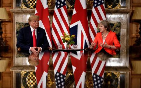 US President Donald Trump listens to Britain's Prime Minister Theresa May prior to a meeting at Chequers, the prime minister's country residence, near Ellesborough, northwest of London on 13 July 2018. Picture: AFP