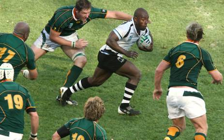 Fiji scrum-half Mosese Rauluni (C) tries to get past South Africa's Schalk Burger (R) and Bakkies Botha (L) during their 2007 Rugby World Cup quarter-final match at the Velodrome stadium in Marseille. Picture: AFP