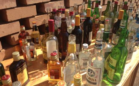 Nearly 100 000 liters of confiscated alcohol and close to 800 000 counterfeit DVDs and CDs have been destroyed by police in the east rand this morning. Picture: EWN