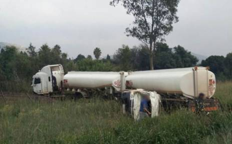 A petrol tanker lying on the side of the road following a collision with a minibus taxi in Strubens Valley on 17 April 2018. Picture: Netcare 911.